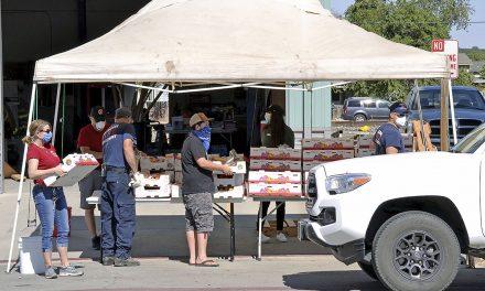 San Miguel Firefighters Association Assists with Fruit Box Giveaway